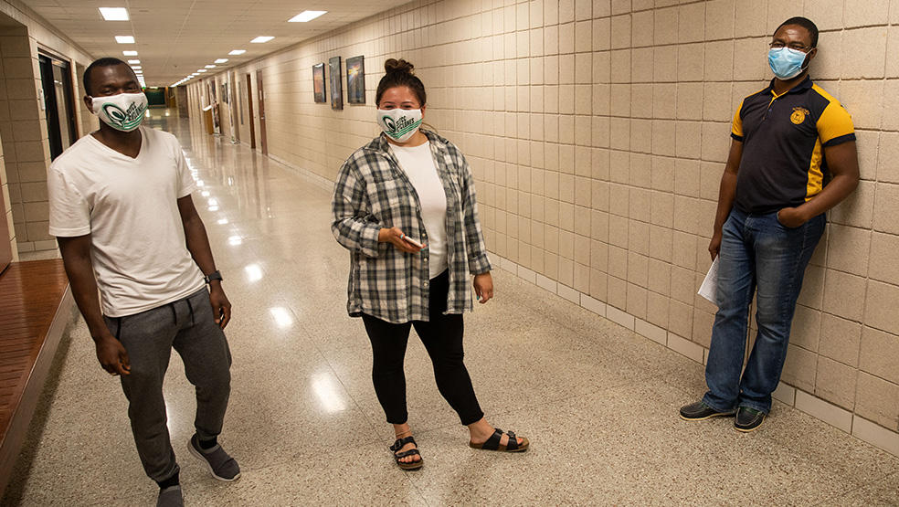 Students in the hallway with masks