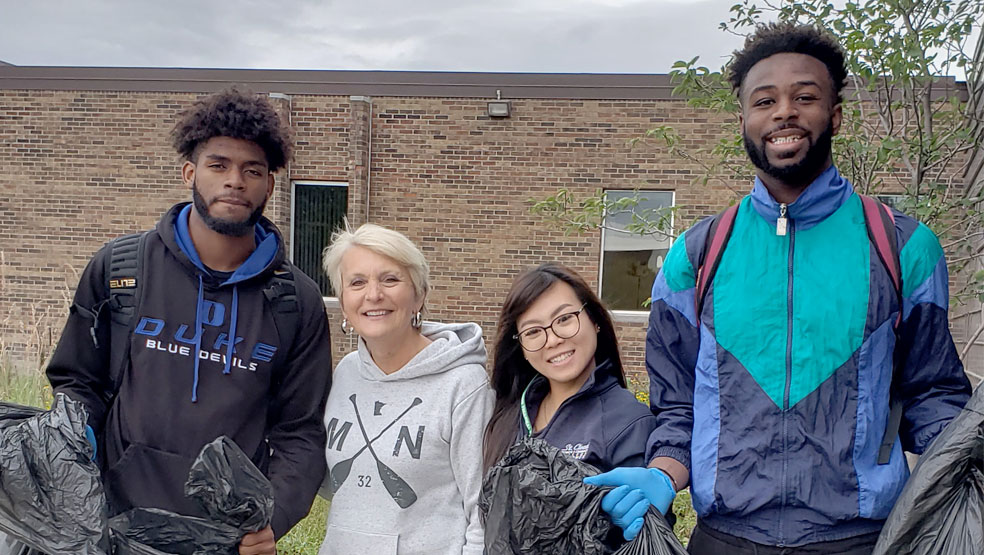 STudents and staff at college cleanup day