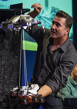 Steltzner demonstrates the Curiosity sky crane landing system. NASA/Bill Ingalls