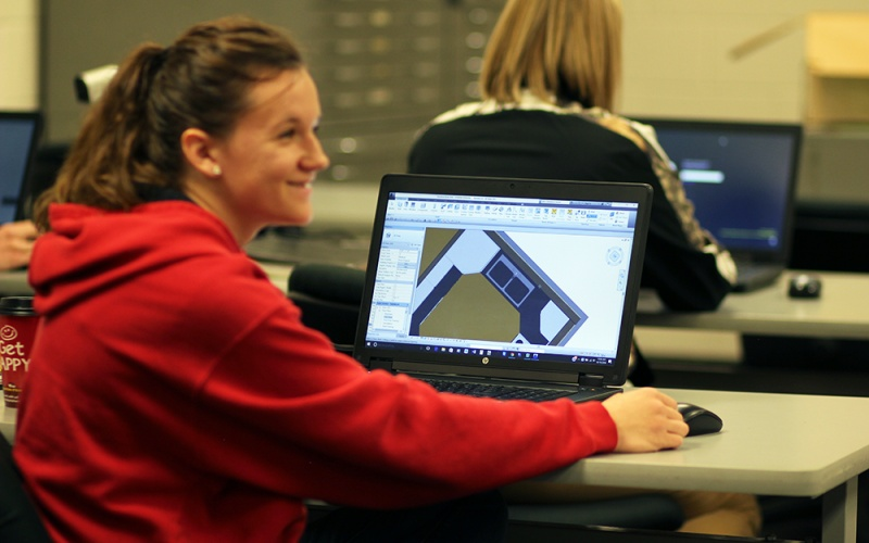 student with architechural progam on computer