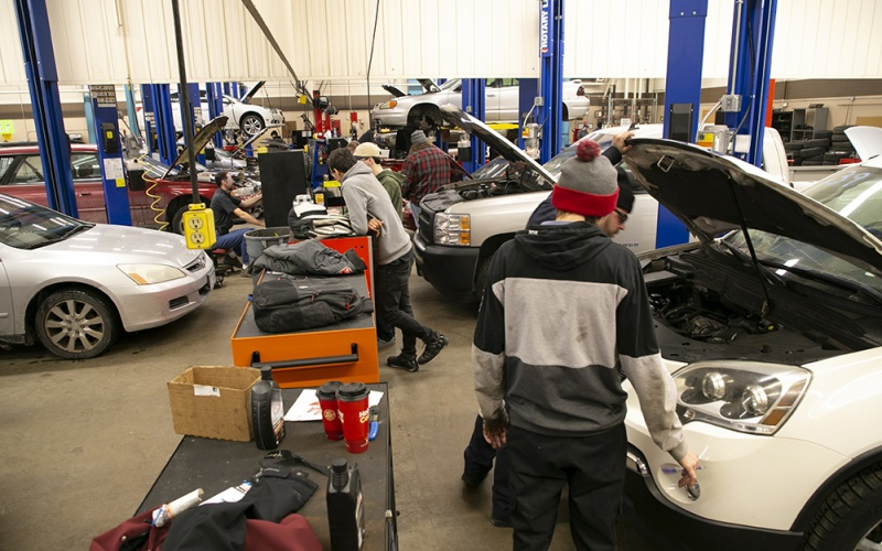 Automotive lab with students working on cars