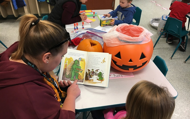 Student's reading to young children