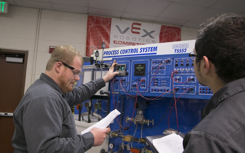 students looking at a process control system