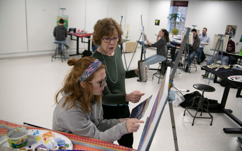 Painting instructor and student