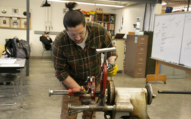 A student working in the plumbing lab