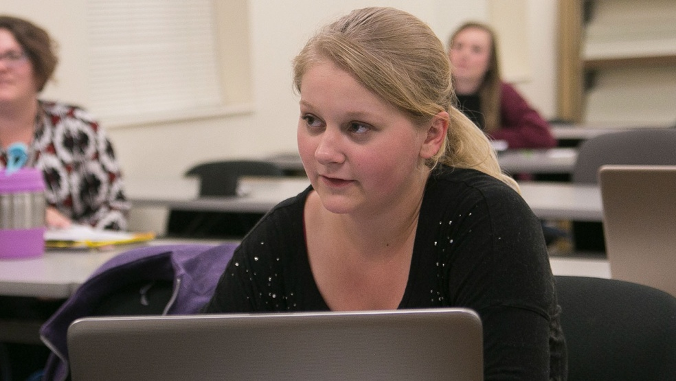Young woman using a laptop while attending a class at SCTCC