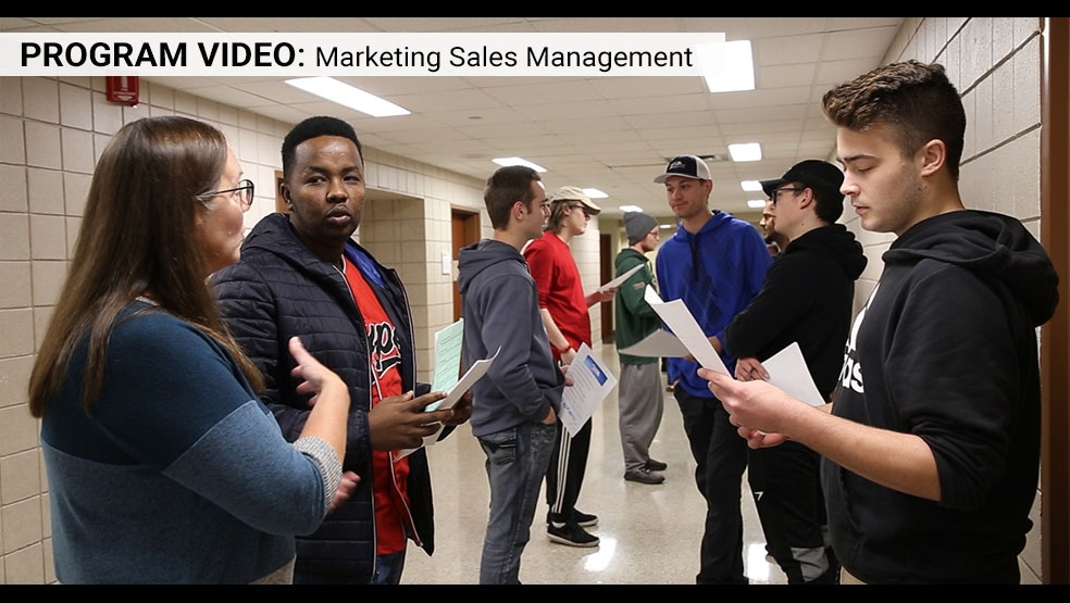 Marketing Sales Management class with students role playing in the hall