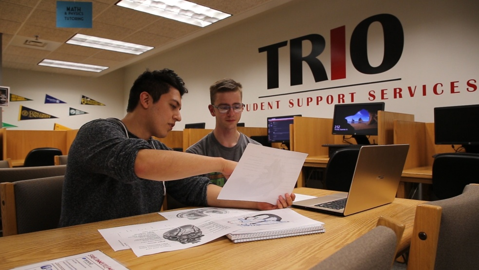 TRIO student tutoring another student
