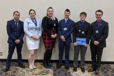 Six students at DECA sporting medals