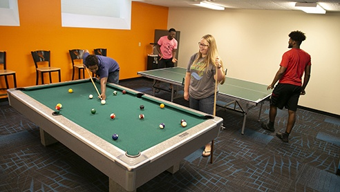 Students playing pool in the Student Lounge