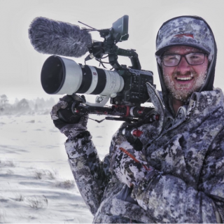 Justin with camera in winter