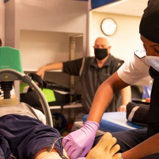 Sainab Gaal works on the paramedicine mannequin in the ambulance sim.